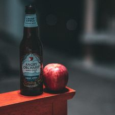 Free Angry Orchard Hard Cider Bottle Beside Red Apple Fruit Stock Photo - 132944720