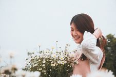 Free Woman Smiling Near Flowers Royalty Free Stock Images - 132945029