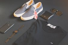 Free Pair Of Gray Vans Low-top Sneakers Beside Black Shirt, Sunglasses, And Watch Royalty Free Stock Photos - 132945068