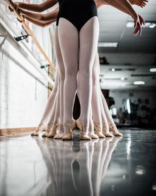 Free Ballerinas Fall In Line Holding Side Handles Stock Image - 133049571