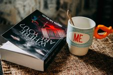 Free Where Are You Book Beside Me Printed Cup Stock Photo - 133049610