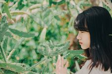 Free Woman Standing Near And Touching Cactus Stock Image - 133099471