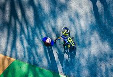 Free Top View Photo Of Kid Near Bicycle Stock Photography - 133253032