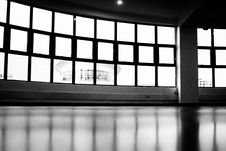 Free Low-angle And Grayscale Photography Of Glass Pane Windows Overlooking Round Building Royalty Free Stock Images - 133488949