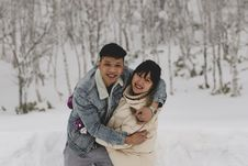 Free Man And Woman Embracing Each Other On Winter Outdoors Royalty Free Stock Image - 133489096