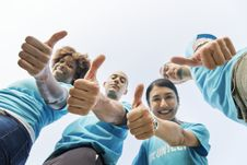 Free Four People Looking Down And Showing Thumb Up Gesture Royalty Free Stock Images - 133489199