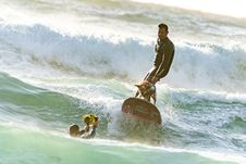Free Surfer With His Surfer Dog Surfing Royalty Free Stock Image - 133489706