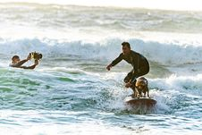 Free Surfer Surfing With His Surfer Dog Royalty Free Stock Image - 133489796