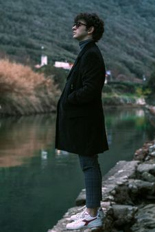 Free Man Wearing Coat Standing Beside Body Of Water Stock Photos - 133489833