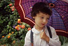 Free Boy Holding Purple Umbrella Stock Photo - 133728520