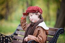 Free Boy Wearing Red Beret Cap While Sitting On Bench Royalty Free Stock Photography - 133728897