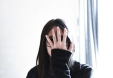 Free Woman Covering Her Face Royalty Free Stock Photo - 133729085