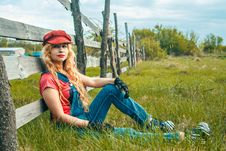 Free Woman Leaning On Wooden Fence Outdoors Stock Photo - 133729140