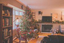 Free Green Christmas Tree Beside Window Inside Room Stock Images - 133729194