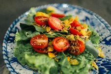 Free Lettuce Salad Cherry Tomatoes On White And Blue Plate Close-up Photography Stock Photo - 133729470
