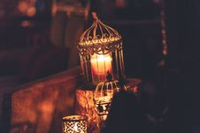 Free Brown Metal Cage With Lighted Candle Stock Images - 133729524