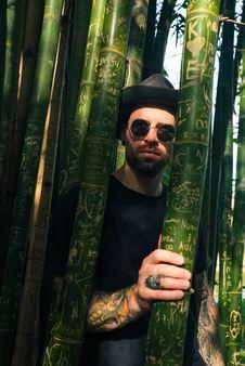 Free Man Through Bamboo Trees Stock Image - 133729541