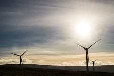 Free Silhouette Of Windmills On Field Stock Photos - 133729833
