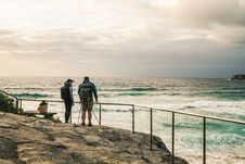 Free Man And Woman Standing On The Rocky Edge With Hand Rail Beside Ocean Royalty Free Stock Images - 133792209