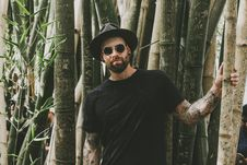 Free Photo Of Man Standing Near Bamboo Trees Royalty Free Stock Photography - 133792247
