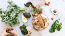 Free Flat-lay Photograph Of Bread, Tomatoes, And Avocados Royalty Free Stock Image - 133893266