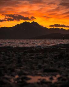 Free Silhouette Of Mountains During Orange Sunset Stock Photo - 133893300