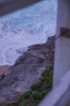 Free Gray Rocky Cliff Beside Beach Waves Stock Photos - 133893313