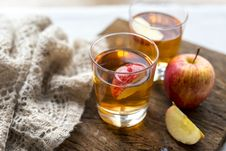 Free Honey Crisp Apple Beside Two Drinking Glasses Royalty Free Stock Photography - 133968747