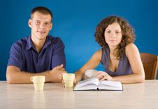 Free Young Couple At The Table With Book Royalty Free Stock Image - 1340326
