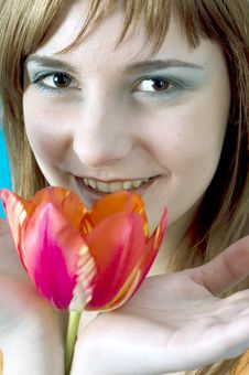 Smiling Behind A Tulip Stock Image
