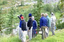 Free Hikers Looking Up Mt Rainier Royalty Free Stock Images - 1345929