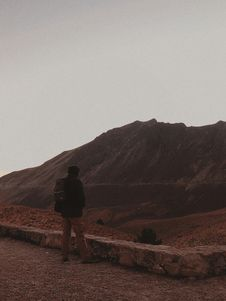 Free Man In Black Jacket Standing On Mountain Stock Image - 134072201