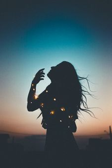 Free Silhouette Of Woman With String Lights Royalty Free Stock Photos - 134168218