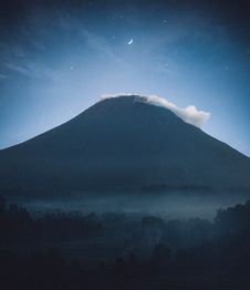 Free Silhouette Of Mountain With Mist On Top Stock Photos - 134169413