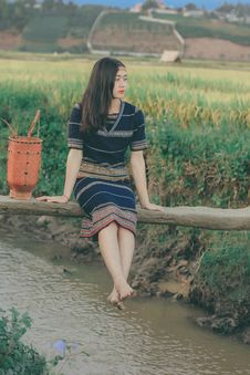 Free Woman Sitting On Bridge Over Flowing Water Stock Photo - 134169770