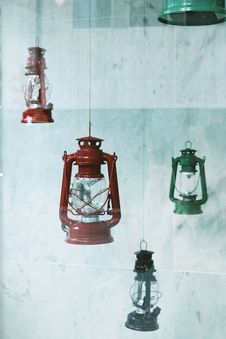 Free Four Assorted-color Metal Gas Lanterns Hanging Near Tile Wall Stock Photo - 134249780