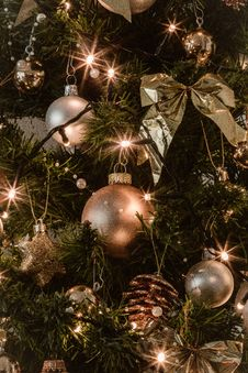 Free Gray And Gold Baubles Hanging On Christmas Tree Stock Photography - 134249782