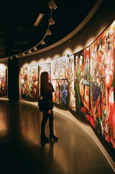 Free Woman Standing Near Paintings Stock Photography - 134421342