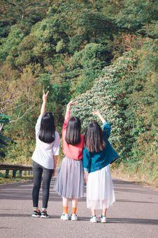 Free Three Women Standing On Street Near Mountain Royalty Free Stock Photography - 134421457