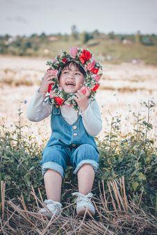 Free Photo Of Girl Sitting While Holding Flower Headband Stock Photos - 134421523