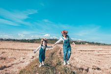 Free Woman And Girl Doing Hand In Hand Whole Walking On Grass Field Stock Images - 134421544