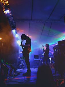 Free Band Playing Music On Stage Royalty Free Stock Photo - 134472595