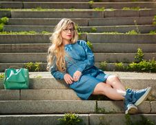 Free Woman In Blue Dress Sitting On Stairs Royalty Free Stock Image - 134472596