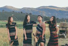 Free Three Women And One Man Standing Near Rice Paddy Stock Image - 134472781