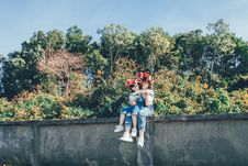 Free Woman And Girl Sitting On Concrete Wall Royalty Free Stock Images - 134472829