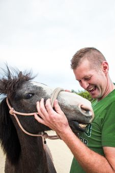 Free Man Holding A Horse Stock Photography - 134721762