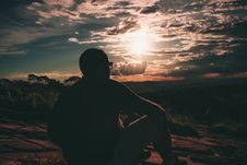 Free Photo Of Man Sitting During Golden Hour Stock Photography - 134822112
