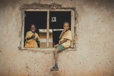 Free Boys In School Uniform Sitting On Window Frame Of An Unfinished Classroom Royalty Free Stock Photos - 134879528