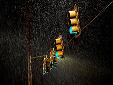 Free Four Traffic Lights Under The Rain Stock Photography - 134879542
