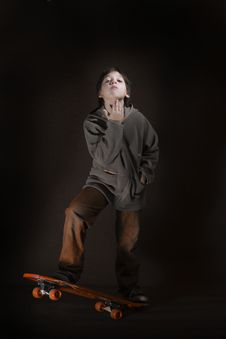 Free Skater Boy With A Cool Attitude. Grunge Style Stock Image - 1354311